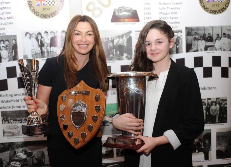 Television presenter Suzi Perry presents Abbi Pulling with her trophies at the 2016 BWRDC Awards dinner